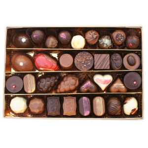 vintage gift box open with chocolates visible
