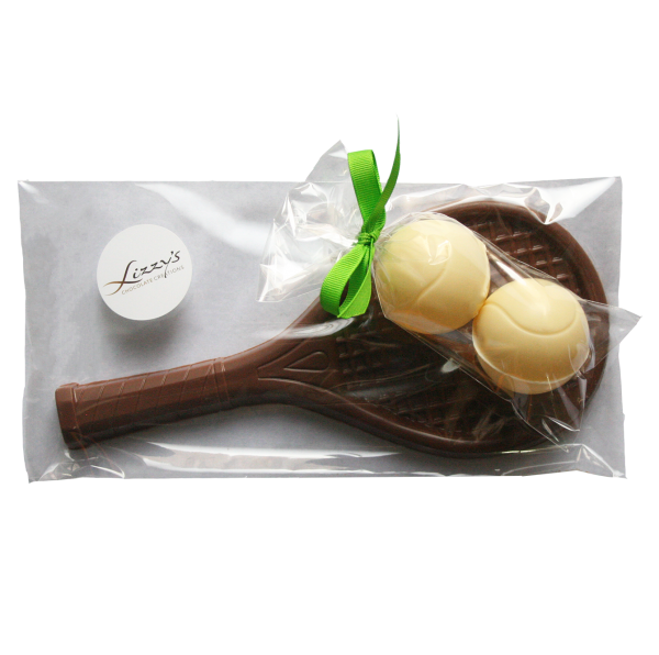 chocolate tennis racquet with two chocolate tennis balls attached