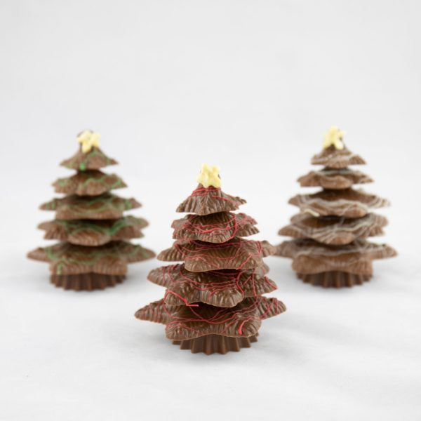 small solid chocolate trees with coloured chocolate tinsel