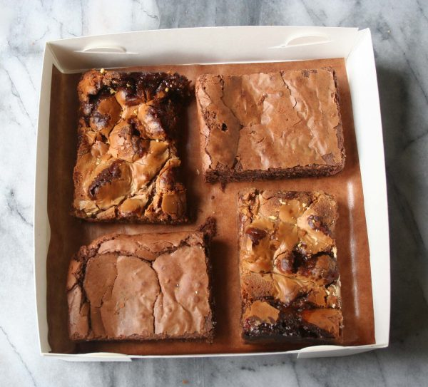 Four brownies in a box