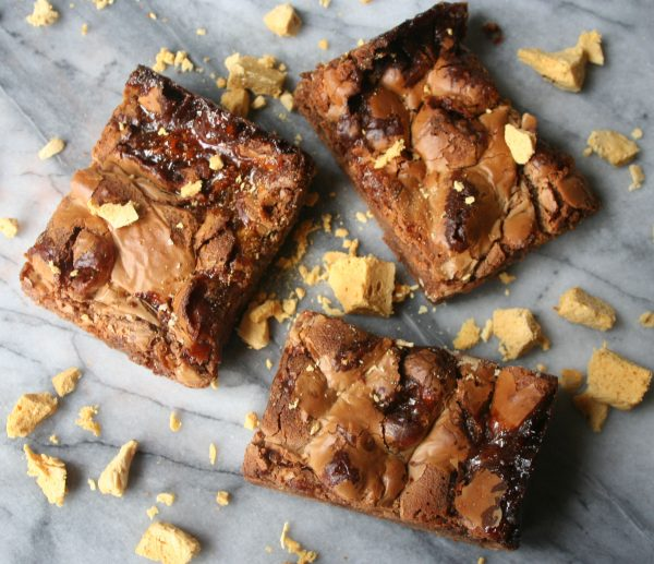 three Honeycomb chocolate brownies with honeycomb crumbled ontop