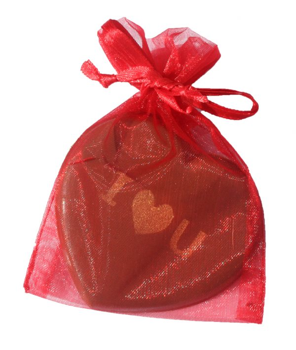 An individual chocolate heart with I ♥️ U written on it