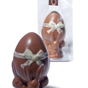 bunnies holding an Easter egg with a white painted bow