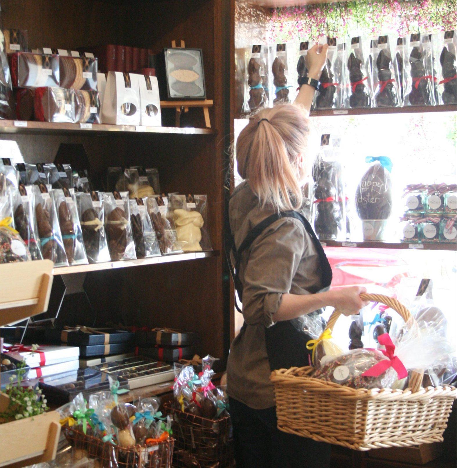 Staff member stocking shelves