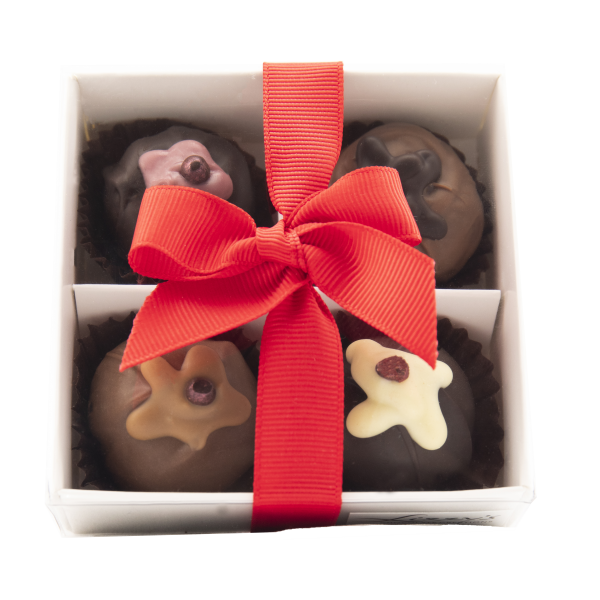 Four puddings inside a clear gift box