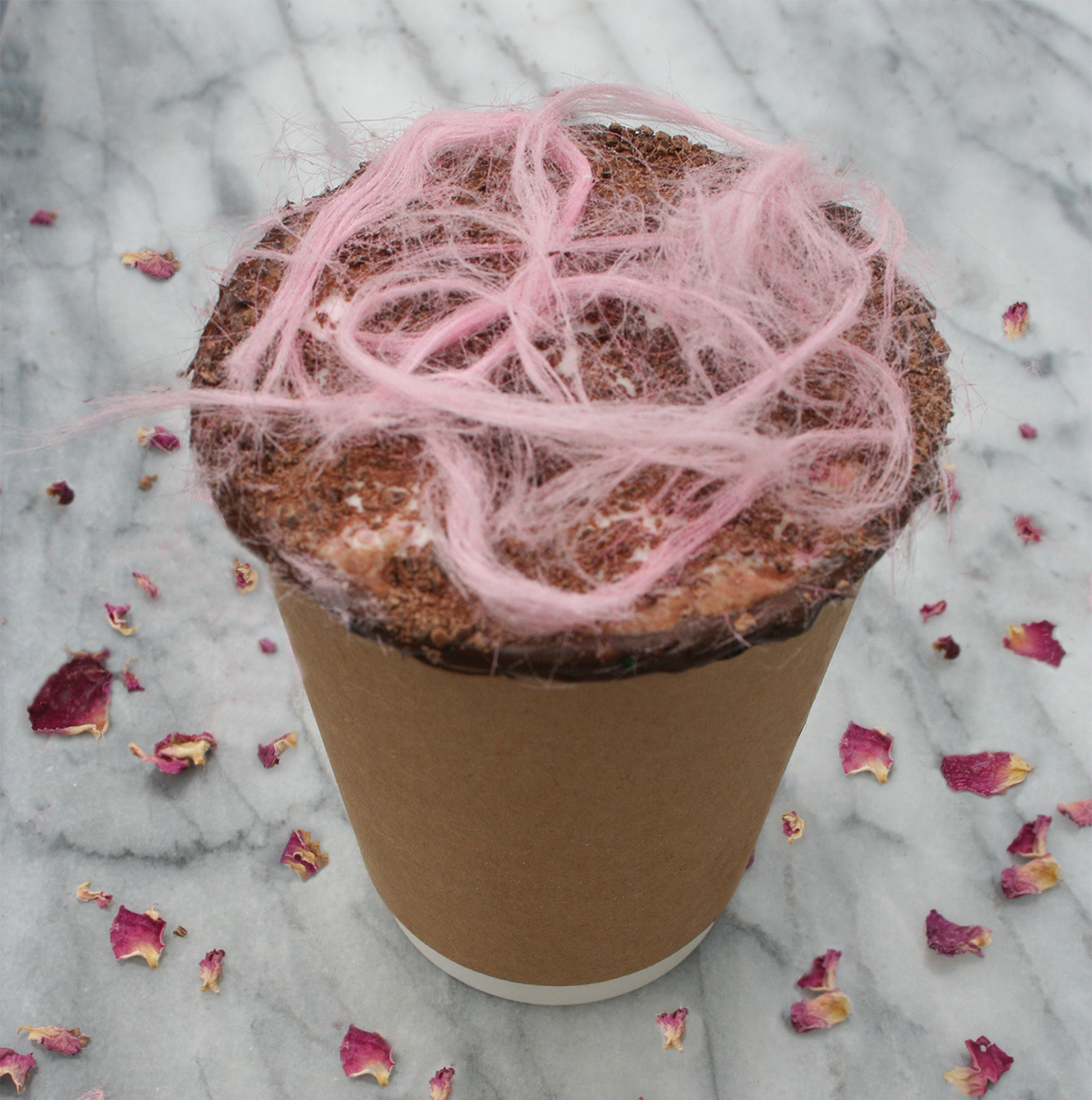 rose hot chocolate in a take away cup